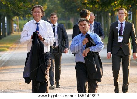 POTSDAM GERMANY. SEPTEMBER 1ST 2016: Bert Koenders (L) Minister of Foreign Affairs of Kingdom of the Nederland and Pavlo Klimkin (R) Minister of Foreign Affairs of Ukraine walking in the park during the Informal OSCE Foreign Minister's Meeting held in Pot