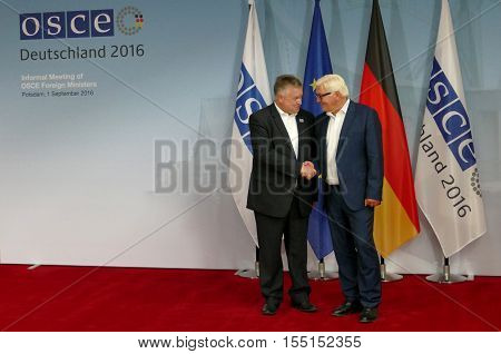 POTSDAM GERMANY. SEPTEMBER 1ST 2016: Federal Foreign Minister Dr Frank-Walter Steinmeier welcomes Michael Link Director of the Office for Democratic Institutions and Human Rights of the Organisation for Security and Co-operation in Europe to the Informal