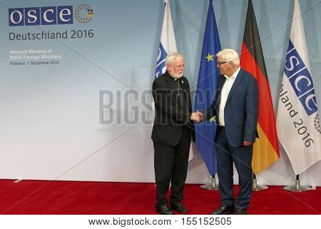 POTSDAM GERMANY. SEPTEMBER 1ST 2016: Federal Foreign Minister Dr Frank-Walter Steinmeier welcomes Archbishop Paul Galagher Holy See Secretary for Relations whit States to the Informal OSCE Foreign Minister's Meeting held in Potsdam Germany