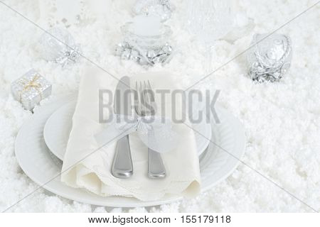 christmas snow dinner table setting with a candle