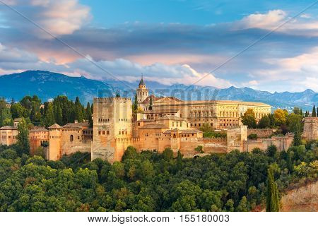 poster of Palace and fortress complex Alhambra with Comares Tower, Palacios Nazaries and Palace of Charles V during sunset in Granada, Andalusia, Spain