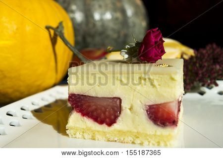 Fresh Strawberry Cream Cake - Layers of strawberry cream and cake topped wth marzipan and deep autumn rose and sugar daisy garnish light up the autumn Thanksgiving special occasion dinner table