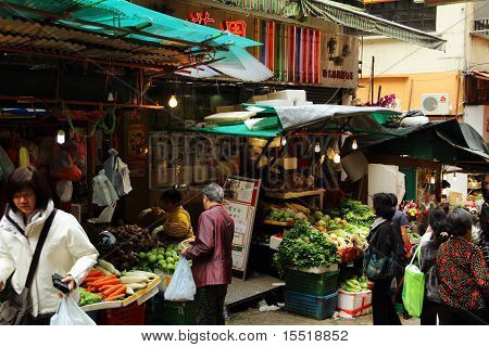 Hong Kong locals buying vegetables at street market