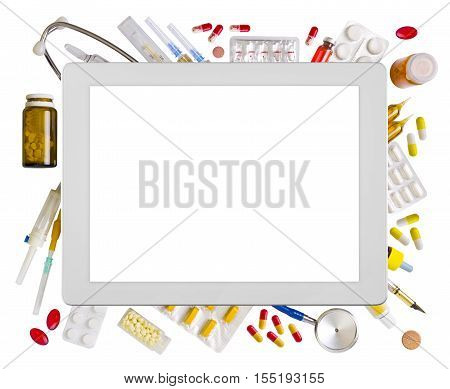 Tablet computer surrounded by various medical supplies