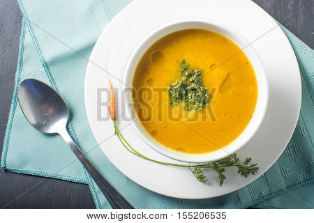 healthful bowl soup pumpkin puree orange with garnish
