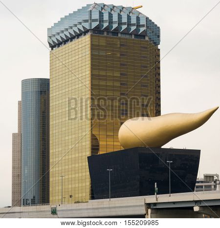 Tokyo Japan - September 28 2016: The two Asahi corporate buildings with two adjacent towers. Tallest one represents the image of a golden lager in a glass. Other is museum with flame on top. Highway in front.
