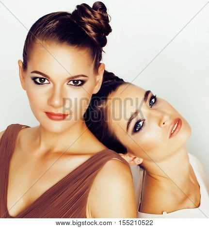 pretty stylish young woman with same hairstyle and makeup, best friend together having fun, lifestyle people concept close up