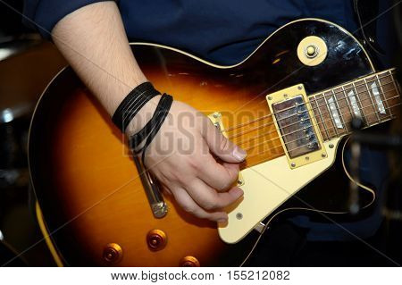 Electric guitar - stringed musical instrument. Accompanying or solo instrument in many styles of music: blues and country, flamenco and rock, metal and jazz. Instrument musicians and rock groups.