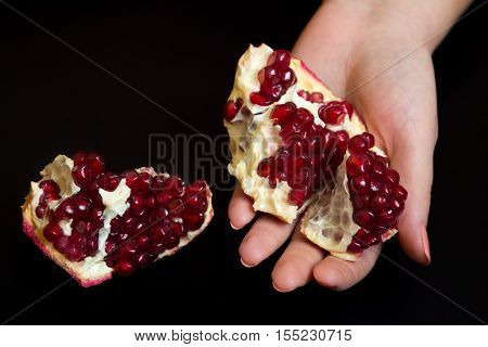 Purified Pomegranate Fruit In A Female Hand