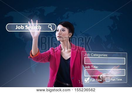 Young Asian woman using a virtual screen to find jobs online. Concept of online job searching