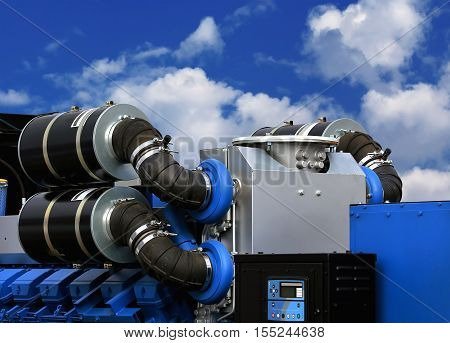 Air intakes with inhaler on the top of the gas turbine engine and a power generator mounted on a steel frame