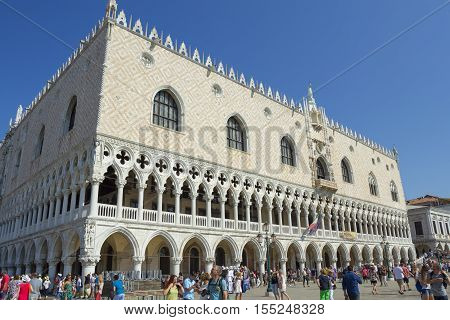 Venice Italy - September 8, 2016: People walking by the Doge Palace in Venice Italy.