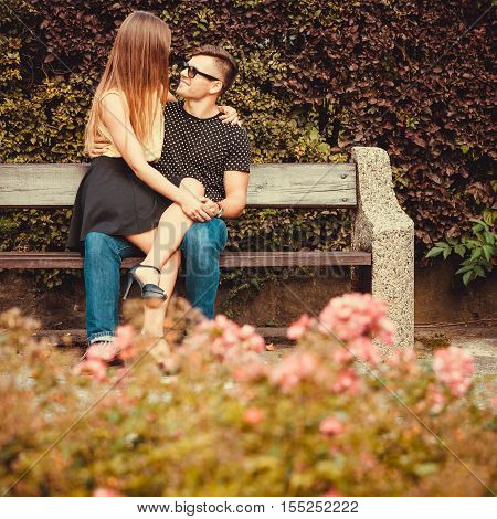 Affectionate Couple Sitting On Bench.