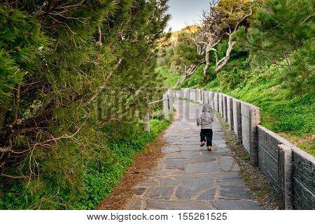 Little boy running along the pathway at Port Elliot South Australia