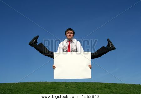 Businessman Jumping With Blank Sign
