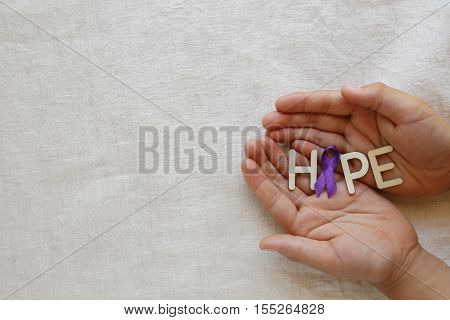 Hands Holding Hope With Purple Ribbon, Copy Space Background, Alzheimer's Disease, Pancreatic Cancer
