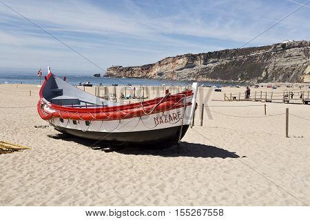 NAZARE, PORTUGAL - September 12, 2016: View of the colourful traditional fishing boats on the beach of the fishing village of Nazare Portugal