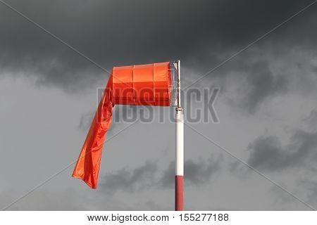 Wind sock of equipment check the wind blow direction in day time and no wind blow on overcast sky cloudy.