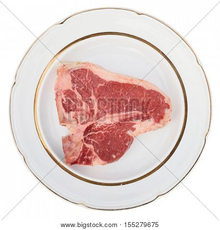 Raw T-bone steak on a rustic plate, isolated on white background