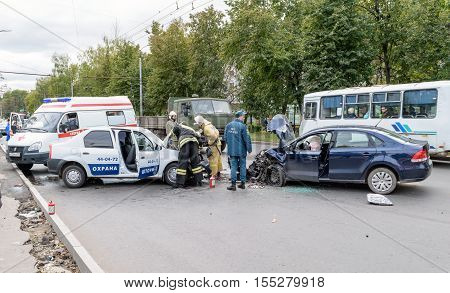 Orel, Russia - September 27, 2016: Employees of the Ministry of Emergency Situations (rescuers) and car of ambulance medical care in place of traffic accident
