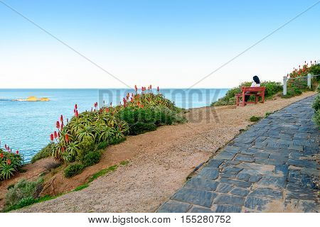 Woman sitting on bench with view at Horseshoe Bay Port Elliot South Australia