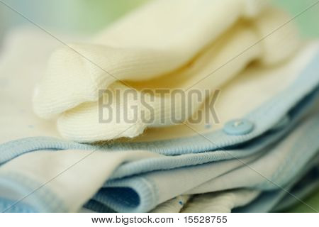 A macro shot of baby clothing and socks