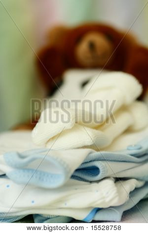 A shot of baby clothing and doll in a nursery