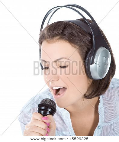 Caucasian Female Singing Into Microphone.