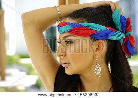 Beautiful Fashion East Woman Portrait.asian Girl In A African Violet Headscarf Praying. Red Nail.