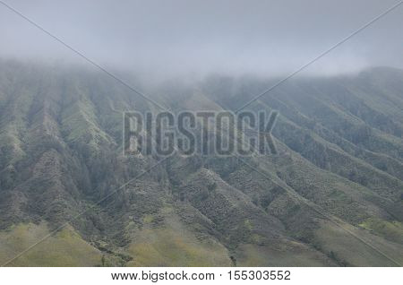 Climbing the volcano Bromo Indonesia. Clouds obscured the crater and green valley