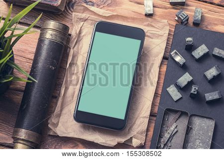 Top view smartphone mock-up on table, with spyglass and so on. Clipping path