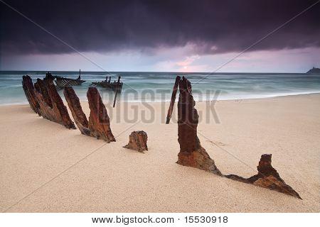 Wreck On Australian Beach At Sunrise