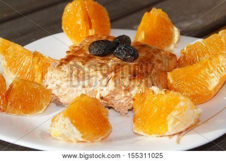 Roasted Salmon with Orange sauce olives and arugula