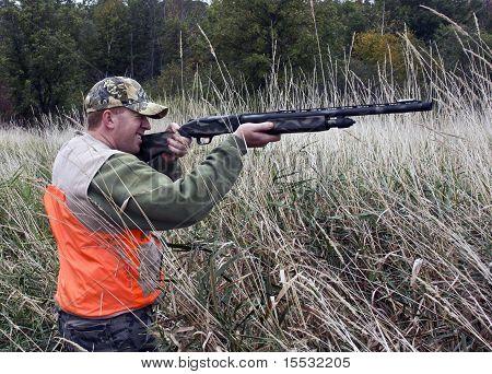 Hunter In Marsh Grass