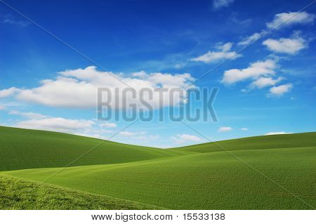 Rolling green hills and a blue sky