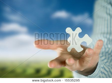 A man holding a puzzle piece.