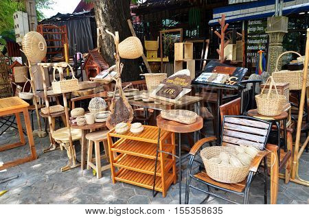Wooden furniture outside their furniture business in Siem Reap Cambodia