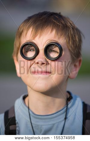 Young kid portrait with funny lenses on his eyes