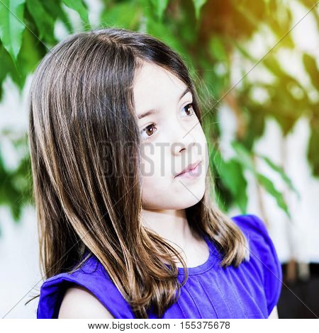 Portrait of cute girl concentrated at home