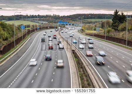 LONDON UK - 07 NOVEMBER 2016: British motorway M25 in a grey cloudy day
