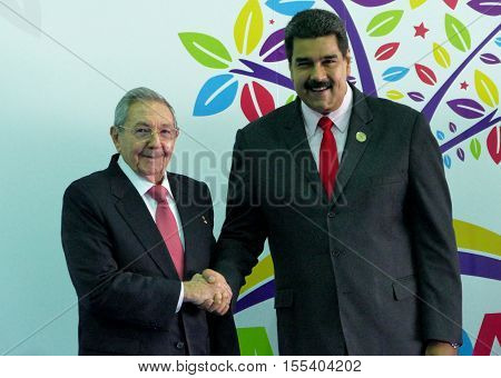 Porlamar Venezuela. September 17th 2016: Cuban President Raul Castro greets Venezuelan President Nicolas Maduro at the opening ceremony of the Non-Aligned Movement Summit in Porlamar Venezuela
