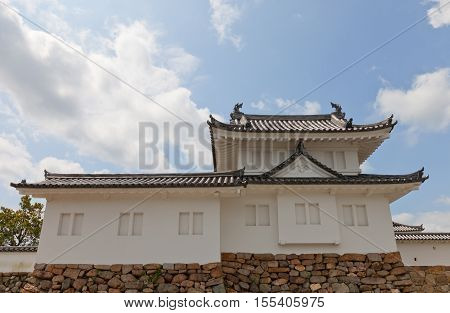 MAIZURU JAPAN - JULY 29 2016: Reconstructed in 1940 Corner Turret of Tanabe castle. Castle was erected in 1579 by Hosokawa Fujitaka abandoned in 19th c. partly reconstructed in 1940 and 1997