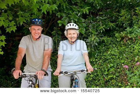 Senior couple mountain biking outside