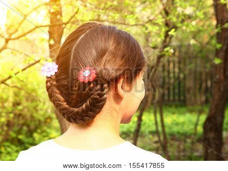 teen girl plaited hair style with country fashion variation close up back photo