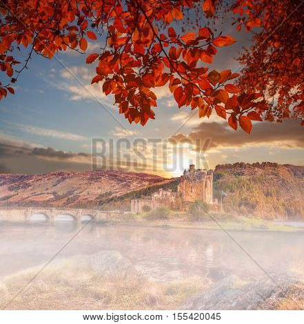 Eilean Donan Castle Against Autumn Leaves In Highlands Of Scotland