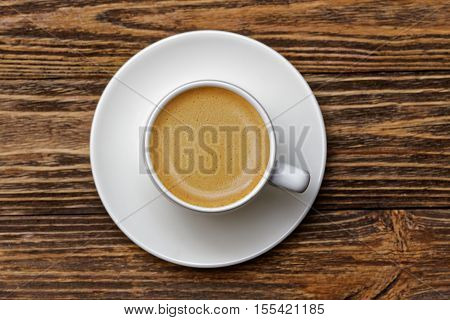 White Cup Of Espresso On Wooden Table