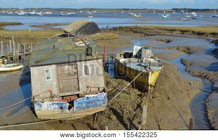 Old disused wooden boat in the mud flats