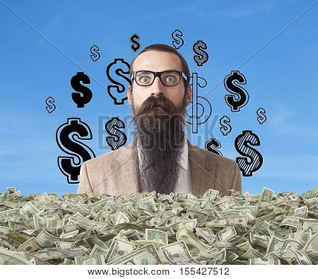 Baffled businessman with long beard is buried in money stacks. Dollar signs are drawn in the sky behind him. Concept of being rich