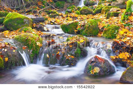 beautiful cascade waterfall in autumn forest