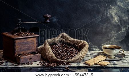 Smell of vintage brewing coffee on old wooden table